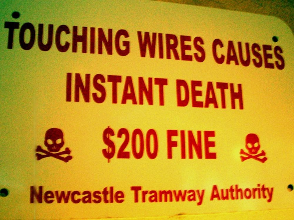 Touching wires causes instant death 200 fine-min